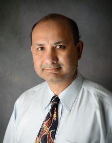 Dr. Manish Dhawan
